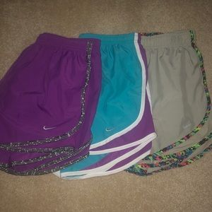 three pairs of Nike running shorts size medium